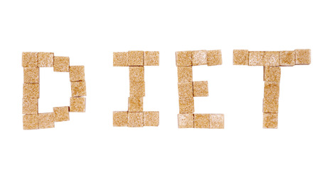alphabetic character: Diet word from brown sugar cubes Stock Photo