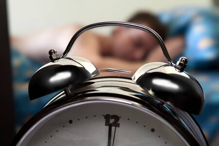 get tired: ringing alarm clock Stock Photo