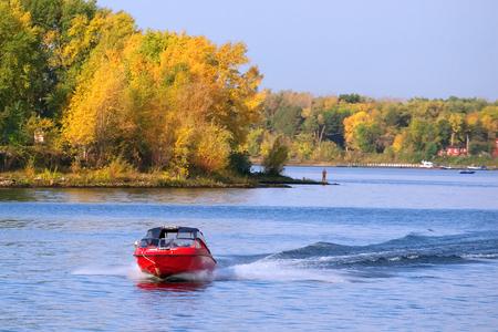 speedboat: speedboat at the autumn river Stock Photo