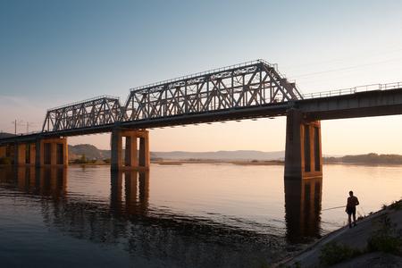 Fishing under railroad bridge