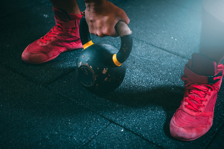 Kettle bell training in a gymnasium for fitness Standard-Bild - 94284367