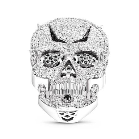 Isolated image of jewelry on a white background. Skull made of silver. Decoration in the form of a metal skull with white stones.
