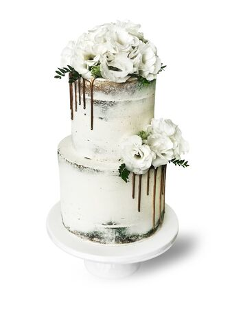 Beautiful wedding cake on a white background with flowers.