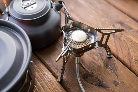 tourist gas burner and utensils standing on the table