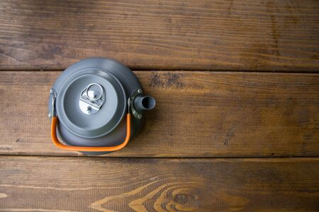 tourist gray teapot standing on the table Standard-Bild