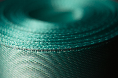 abstraktsionnoe Photo skein turquoise ribbon with a sheer fabric structure