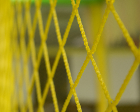 abstract yellow grid of rhombuses leaving in perspective