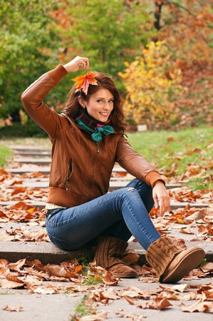 Young pretty woman at the autumn park photo