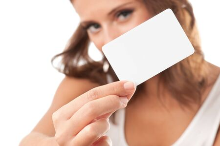 Woman hand holding white empty blank business card, shallow DOF, face in blur Stock Photo - 11706541