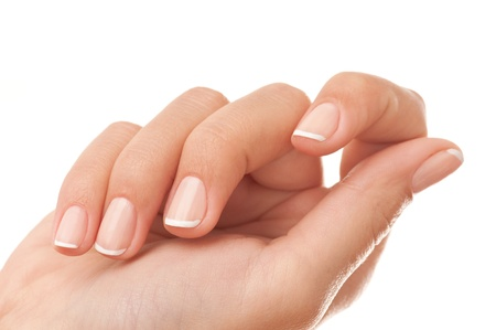 Close-up of woman's hand with French manicure isolated on white. Standard-Bild