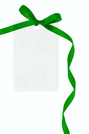 A blank gift or price tag tied with green ribbon isolated on a white background Stock Photo - 11703293