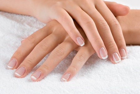 nails manicure: Nice hands on white towel. Soft manicure. Stock Photo