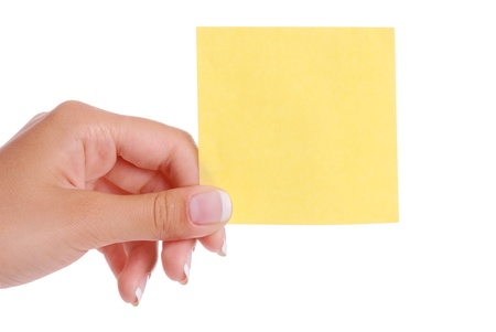 sticky hands: Woman hand holding yellow blank notepaper isolated on white background