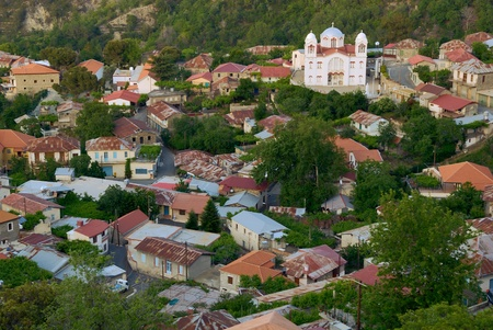 small town life: Lots of houses and church in small town in mountain viewed from above, Cyprus