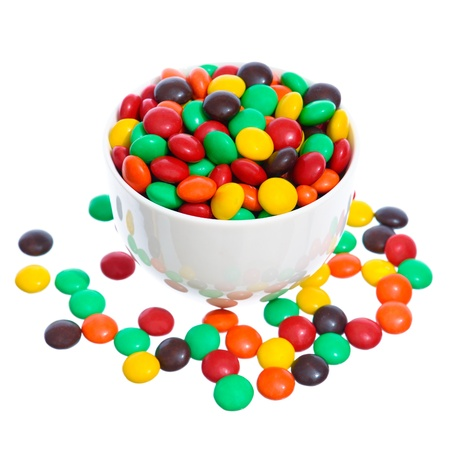 plateful: White bowl full of candies isolated on white.