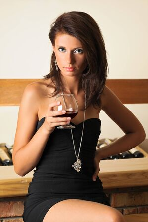 Portrait of beautiful woman with glass of cognac photo