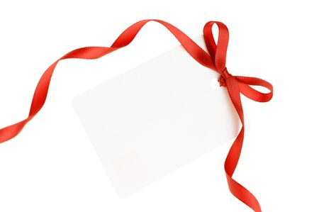 A blank gift or price tag tied with red ribbon isolated on a white background  Stock Photo - 11703276