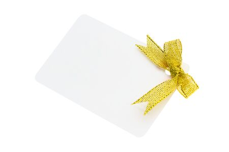 A blank gift or price tag tied with yellow ribbon isolated on a white background Stock Photo - 11703284