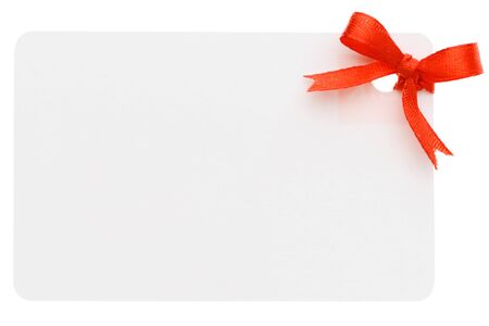 A blank gift or price tag tied with red ribbon isolated on a white background Stock Photo - 11703268