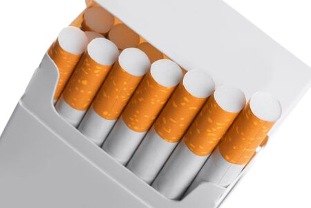 Pack of cigarettes with cigarettes sticking out isolated on white, close-up  photo