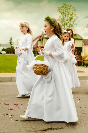 solemnity: Radomsko, Poland - June 7, 2012.: Participants in the procession of Corpus Christi on June 7 2012 in Radomsko, Poland. Corpus Christi (feast), a Christian feast day, or solemnity which honors the Body (corpus) of Christ (Christi),