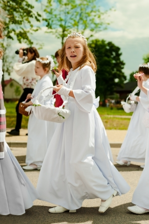 Radomsko, Poland - June 7, 2012.: Participants in the procession of Corpus Christi on June 7 2012 in Radomsko, Poland. Corpus Christi (feast), a Christian feast day, or solemnity which honors the Body (corpus) of Christ (Christi),