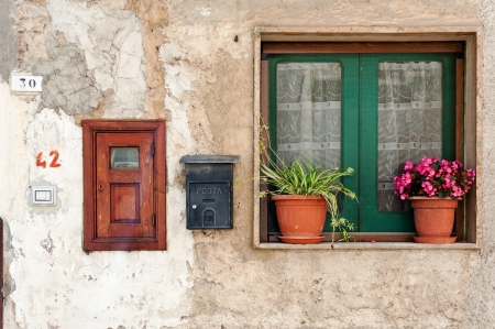 Photo of wall with window and mailbox  Photo taken in Cilento area, Campania, Italy  photo