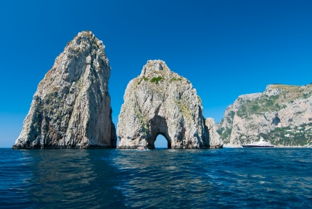 Faraglioni are the three stacks located off the island of Capri in the Bay of Naples  The stacks have been given their own names  Stella  still attached to the main island , Mezzo  after Stella , and Scopolo  or Fuori   스톡 콘텐츠