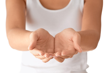hands cupped: Cupped empty hands over body background. Stock Photo