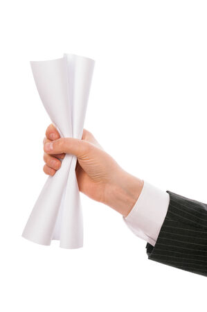 Man holding creased paper in his hand