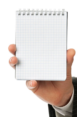 Businessman hand holding notebook on a spring with blank page to write something, isolated photo