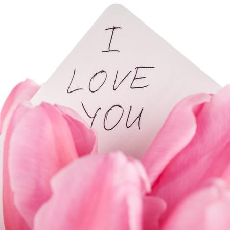 part of me: Ramo de los tulipanes con el 'te amo' Nota aislado en blanco, de cerca.