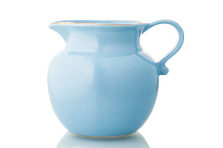 Blue ceramic pitcher isolated on white.