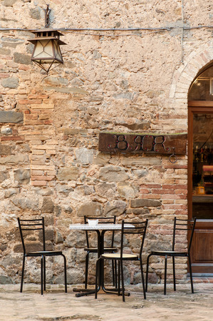 restaurant exterior: Empty table and chairs with Bar sign above in San Marino city. Stock Photo