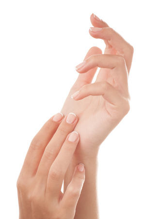 manicure hand: French manicured nails - isolated on white background.