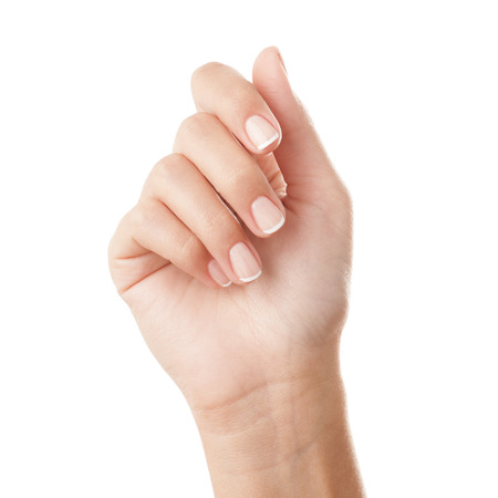 feminine hands: French manicured hand - isolated on white background.