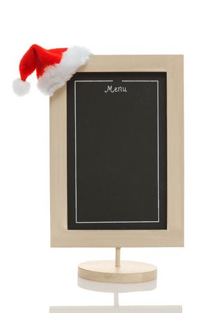 Empty restaurant menu chalkboard with santa claus hat on the conner isolated on white  photo