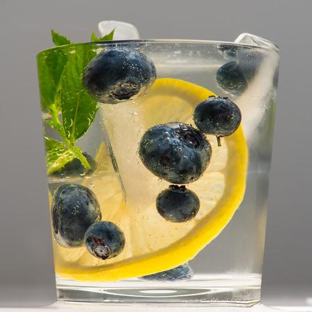 Summer lemonade with blueberries, lemon and mint.
