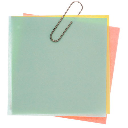 varicoloured: Stack of varicoloured memos with silver paper clip on a pure white background. Waiting for your message.
