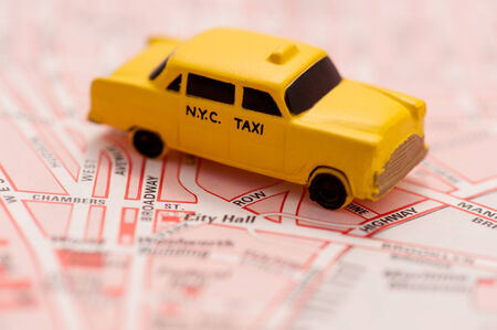 yellow car: Close up of New York city map with a yellow taxi on it taxi - Travel concept.