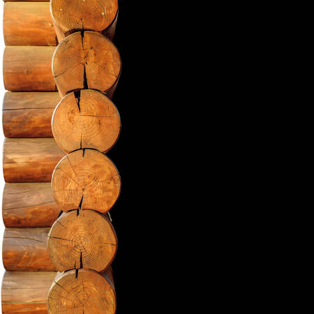 sectioned: Close-up of wooden hause sectioned log with black background for your text.