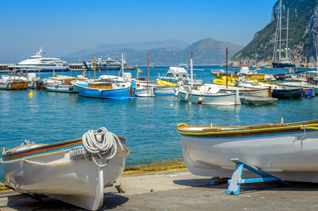 Traditional wooden boats in the harbor at Marina Grande - Capri, Italy photo