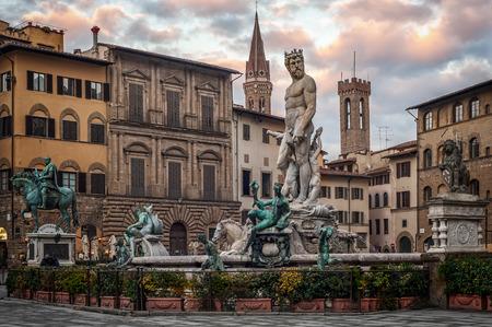 Statue of Neptune in the dusk on Piazza della Signoria, Florence (Italy) Stock Photo