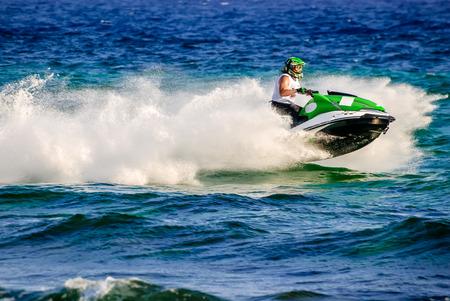 jetski: High speed jetski with water spray. Photo taken in Cyprus.