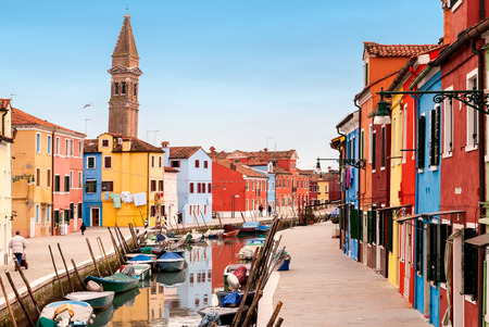 old boat: Venice landmark, Burano island canal, colorful houses and boats, Italy.