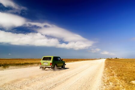 single lane road: Blurred retro car on the ground road. Ukraine.
