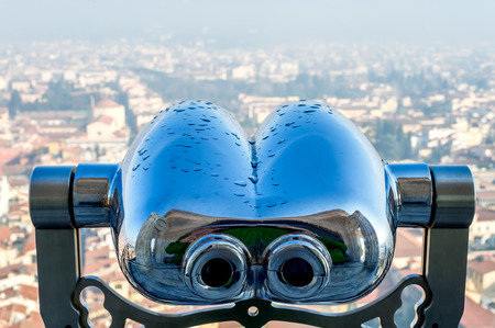Close-up of binocular with view from Florence Duomo on background.  Florence, Tuscany, Italy.