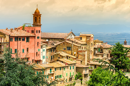 montepulciano: Old town Montepulciano with dramatic sky in Tuscany, Italy