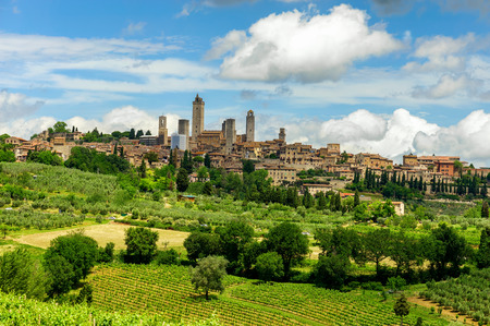 distant: Beautiful view of the medieval town of San Gimignano, Tuscany, Italy