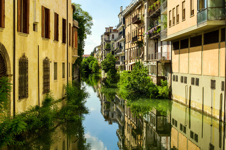 massimo: The city canal San Massimo runs among residential houses in the centre of the old city Padua, Veneto, Italy Stock Photo